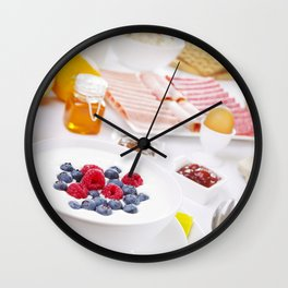 II - Table full with continental breakfast items, brightly lit Wall Clock