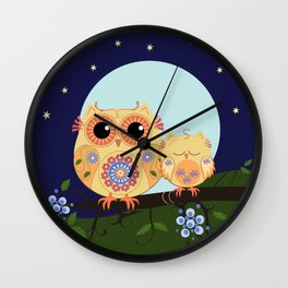 Colourful Flower power owl with her sleepy baby on branch Wall Clock