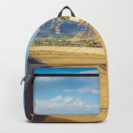 A football field on the mountains on the background A quiet and beautiful place for a football game Backpack
