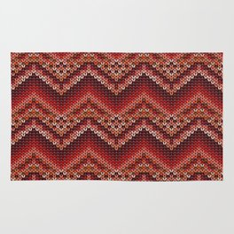 Red knitted zig zag pattern. Rug