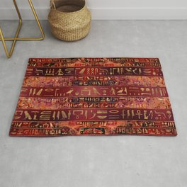 Egyptian hieroglyphs gold on red painted texture Rug
