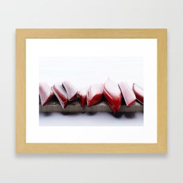 Snowfall on Red Canoes in Jasper National Park Framed Art Print