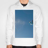 skiing Hoodies featuring Skiing off a jump by Dustin Hall