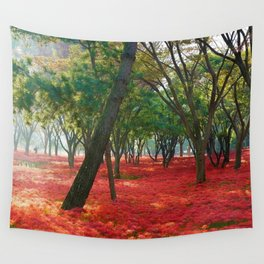Red Resurrection Lilies in full bloom in the forest Wall Tapestry