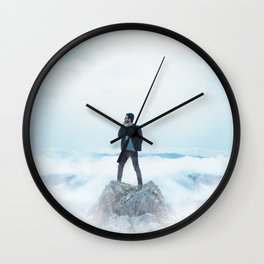 Man standing on the rock Wall Clock