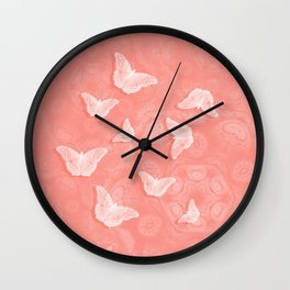 A flutter of butterflies on peach mandala patterns Wall Clock