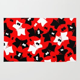 The pattern of butterflies. White and black butterfly on a red background. Rug