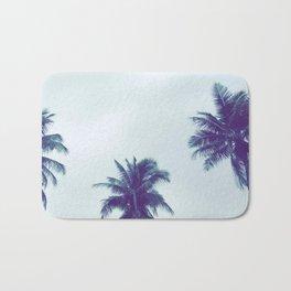 Fijian palm tree canopy in a moody sky Bath Mat