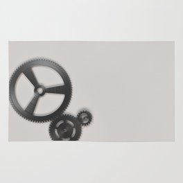 Set of metal gears and cogs on white Rug