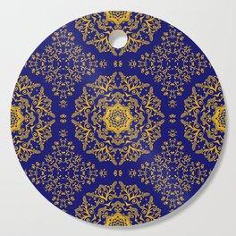 golden mandala pattern on the dark blue background Cutting Board