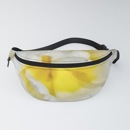 Flower like sunshine on snowy mountains Fanny Pack