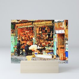 Aleppo: a man with packages passes in front of a shop Mini Art Print