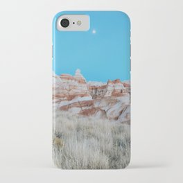 Moon Over Marbled Rock Formation iPhone Case