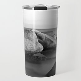 Stones in the sea Travel Mug