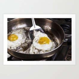 Eggs cooked with bacon grease in pan Art Print