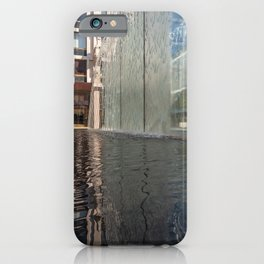 Modern fountain with water splashes on a huge glass window iPhone Case