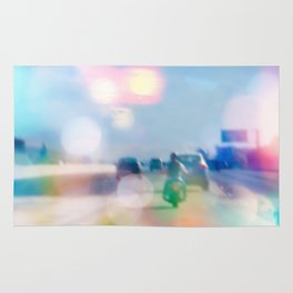 car and motorcycle on the road in the city with bokeh light Rug