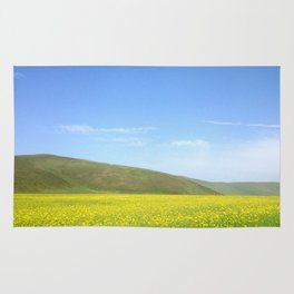 yellow flower field Rug