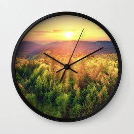 Sunset over forest Wall Clock