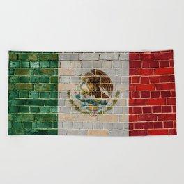 Mexico flag on a brick wall Beach Towel
