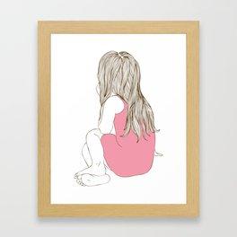 Little girl in a pink dress sitting Framed Art Print