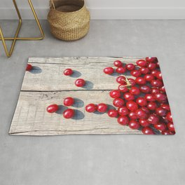 Spilled ripe cherries Rug