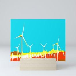 wind turbine in the desert with blue sky Mini Art Print