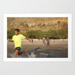 Timorese people play football in Areia Branca beach Art Print