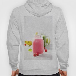 Close-up of pink fresh smoothie with fruits and berries selective focus. Hoody
