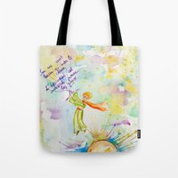 le petit prince Tote Bags featuring Le Petit Prince- The little Prince flying by Colorful Simone