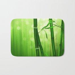 Bamboo Stalks with a Green Bokeh Background Bath Mat