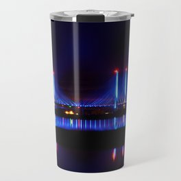The Indian River Inlet bridge reflecting off the bay as beams of blue light penetrate the night sky Travel Mug