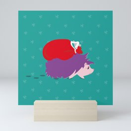 Illustration of a hedgehog bringing Christmas Santa sack, in an abstract winter background with snow Mini Art Print