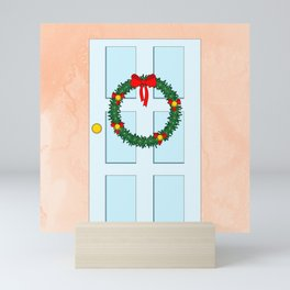 Traditional Christmas wreath on an old fashioned door Mini Art Print