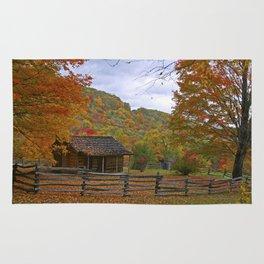 Log Cabin in Autumn Rug
