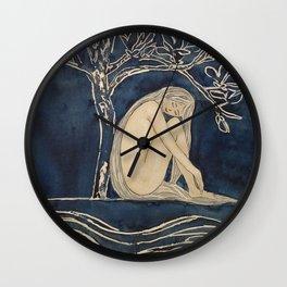 Girl sleeping under magnolia flowers Wall Clock