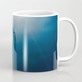 Bubble ring Underwater ascends towards the sun. Coffee Mug