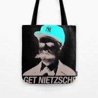 nietzsche Tote Bags featuring Get nietzsche or die tryin' by Carlos Paboudjian