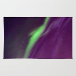 Beautiful northern lights in the sky. Aurora borealis, Kiruna, Sweden. Rug