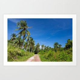 Road with palm trees and clear blue sky Art Print