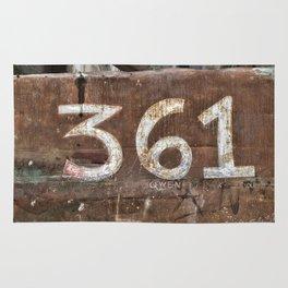 Numbers on rusty door Rug