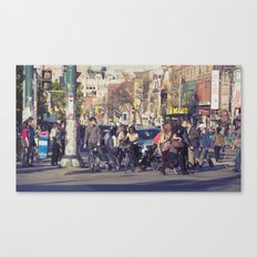man in helmet stares wistfully across a busy intersection... Canvas Print