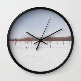 Frozen Orchard Wall Clock