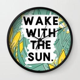 wake the sun Wall Clock