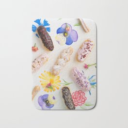 Eclairs with toppings Bath Mat