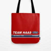 f1 Tote Bags featuring Haas F1 Team 1986 by Krakenspirit