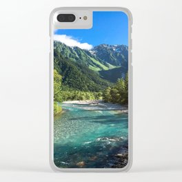 River flowing in front of snow covered mountain Clear iPhone Case