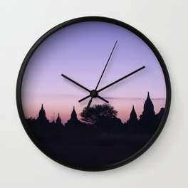 Silhouettes of pagodas during sunset in Bagan Wall Clock