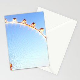 orange Ferris Wheel in the city with blue sky Stationery Cards