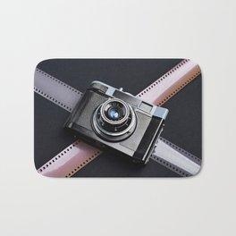 Vintage camera and films on black Bath Mat
